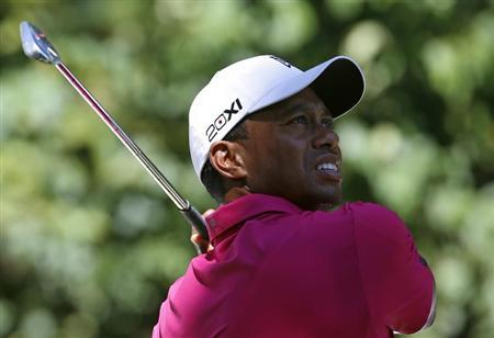 Woods of the U.S. hits from the second tee during the third round of the BMW Championship golf tournament at the Conway Farms Golf Club in Lake Forest