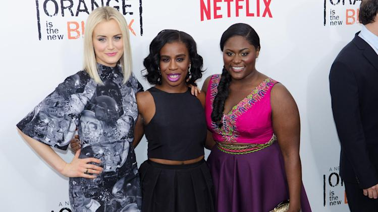 "FILE - In this May 15, 2014, file photo, Taylor Schilling, from left, Uzo Aduba and Danielle Brooks attend Netflix's ""Orange Is The New Black"" Season 2 premiere at the Ziegfeld Theatre in New York. There is fierce jockeying for Emmy nominations in the premier drama and comedy series categories, with newcomers ""True Detective"" and ""Orange is the New Black"" making strategic moves to boost their chances. (Photo by Scott Roth/Invision/AP, File)"