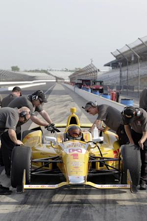 NASCAR driver Kurt Busch sits in an Andretti Autosport Indycar as crewmen attend to it on pit lane during a testing session at the Indianapolis Motor Speedway in Indianapolis, Thursday, May 9, 2013. (AP Photo/AJ Mast)