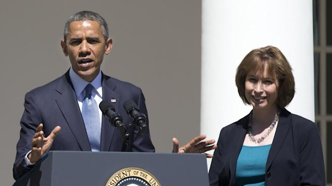 In this June 4, 2013 file photo, President Barack Obama gestures while speaking in the Rose Garden of the White House in Washington, Tuesday, June 4, 2013, to announce the judicial nominations including Patricia Ann Millett, right, to the U.S. Court of Appeals for the District of Columbia Circuit. Senate Democrats have approved a key judicial nominee from President Barack Obama, the first nomination cleared since they weakened Senate filibuster rules.The Senate voted 56-38 to approve Millett's nomination to the U.S. Court of Appeals for the District of Columbia. (AP Photo/Manuel Balce Ceneta, File)