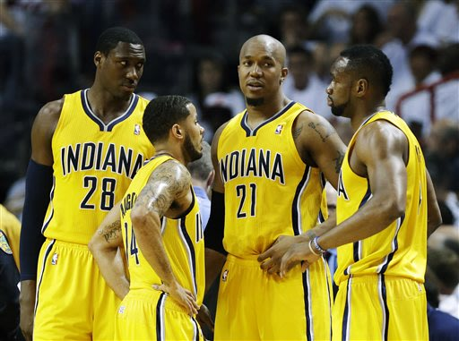 Indiana Pacers center Ian Mahinmi (28), guard D.J. Augustin (14) and Sam Young (4) stand with forward David West (21) during the first half of Game 1 in their NBA basketball Eastern Conference finals