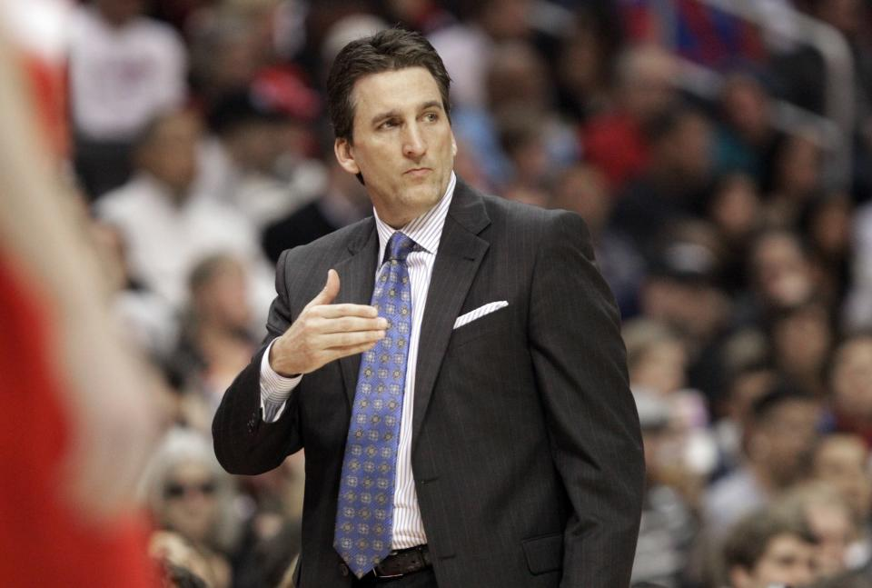 Los Angeles Clippers head coach Vinny Del Negro watches the action in the first half of an NBA basketball game against the Portland Trail Blazers in Los Angeles Tuesday, April 16, 2013. The Clippers won, 93-77. (AP Photo/Reed Saxon)
