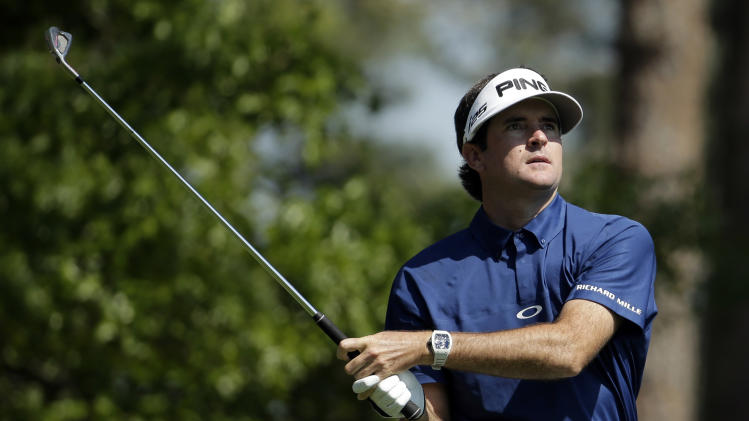Bubba Watson watches his tee shot on the fourth hole during the third round of the Masters golf tournament Saturday, April 12, 2014, in Augusta, Ga