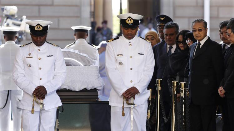 Former Malaysian Prime Minister Mahathir Mohamad pays his respects to former South African President Nelson Mandela as Mandela lies in state for the second day at the Union Buildings in Pretoria