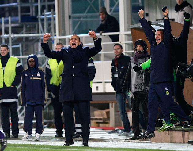 Nantes' French coach Michel Der Zakarian, centre, reacts with Nantes' team members, after defeating Marseille, at the end of their League One soccer match , at the Velodrome Stadium, in Marsei