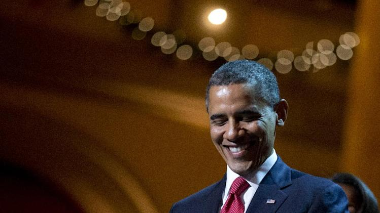 President Barack Obama smiles as he delivers his remarks during the Annual Christmas in Washington presentation at the National Building Museum in Washington, Sunday, Dec. 9, 2012. (AP Photo/Manuel Balce Ceneta)