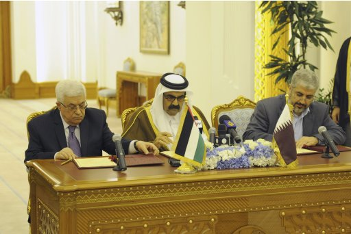 Palestinian President Abbas and Hamas leader Meshaal sign an agreement in Doha