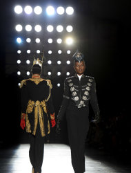 A model wears a design from the Philip Treacy Spring/Summer 2013 collection during London Fashion Week, Sunday, Sept. 16, 2012. (AP Photo/Jonathan Short)