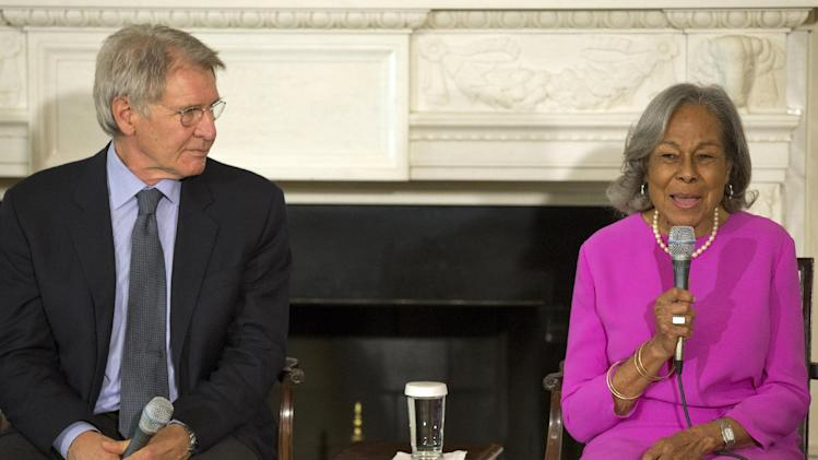 "Actor Harrison Ford listens at left as Rachel Robinson, 90, widow of baseball great Jackie Robinson talks about her late husband during a workshop for high school and college students based on the movie, ""42,"" Tuesday, April 2, 2013, in the State Dining Room of the White House in Washington. (AP Photo/Jacquelyn Martin)"