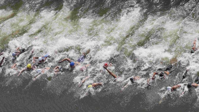 Swimmers start the women's 10km open water race at the Aquatics World Championships in Kazan