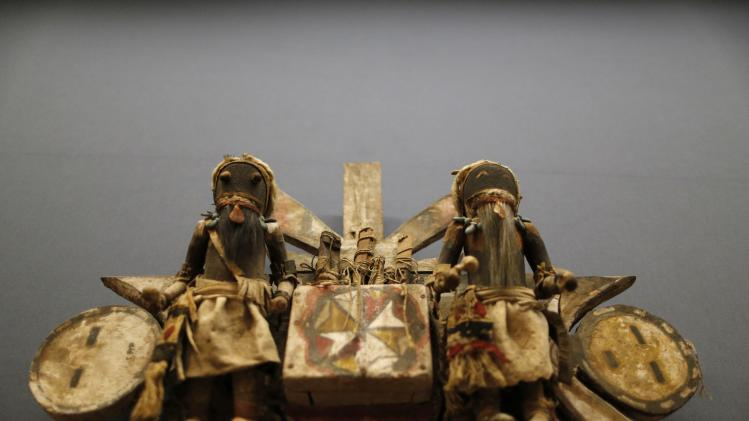 A rare antique Zuni Native American Chakwaina Gods alter is displayed at an auction house in Paris