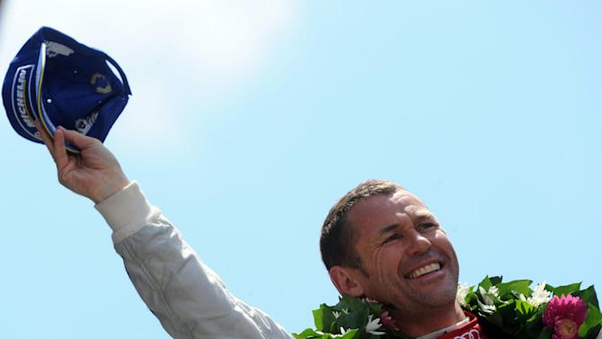 Tom Kristensen, pictured on the podium after taking second place in the 2014 Le Mans race, says he is retiring at the age of 47