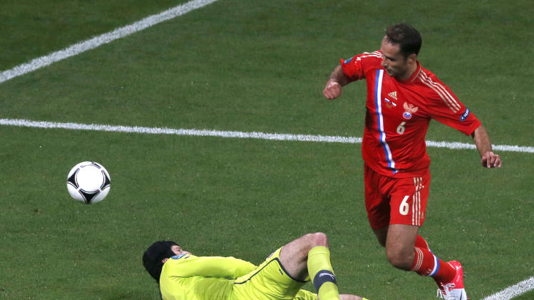 Russia's Roman Shirokov scores past Czech goalkeeper Petr Cech during the Euro 2012, Group A soccer match between Russia and Czech Republic, in Wroclaw, Poland, Friday, June 8, 2012.  (AP Photo/Anja Niedringhaus)