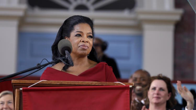 Oprah Winfrey is applauded as she speaks during Harvard University's commencement ceremonies in Cambridge, Mass., Thursday, May 30, 2013. She earlier received an honorary Doctor of Laws degree. (AP Photo/Elise Amendola)