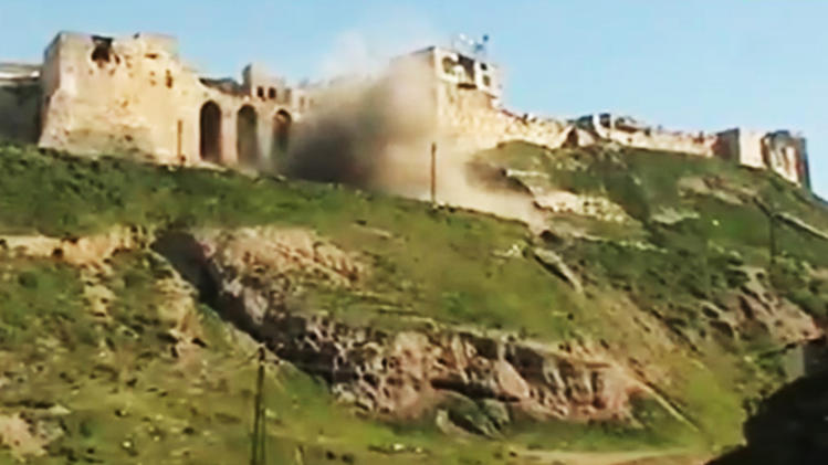 FILE - In this Wednesday, March 21, 2012 file image made from amateur video and released by Ugarit News, purports to show a castle being shelled in Hama, Syria. The chaos from Syria's yearlong revolt is destroying some of the country's most important archaeological sites, and horrified experts warn that some of the Middle East's most precious sites are at risk of destruction and looting. (AP Photo/Ugarit News via APTN, File) THE ASSOCIATED PRESS CANNOT INDEPENDENTLY VERIFY THE CONTENT, DATE, LOCATION OR AUTHENTICITY OF THIS MATERIAL. TV OUT