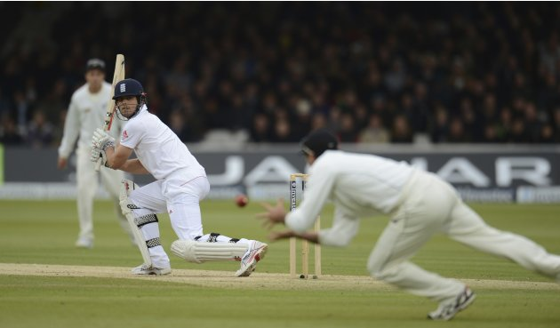 England's Cook looks back as New Zealand's Brownlie catches him for 21 runs during the first test cricket match at Lord's cricket ground in London