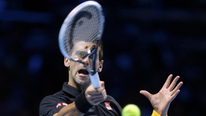 Novak Djokovic of Serbia plays a return to Juan Martin Del Potro of Argentina, during their ATP World Tour Finals singles semifinal tennis match, at the O2 Arena in London, Sunday, Nov. 11, 2012. (AP Photo/Alastair Grant)