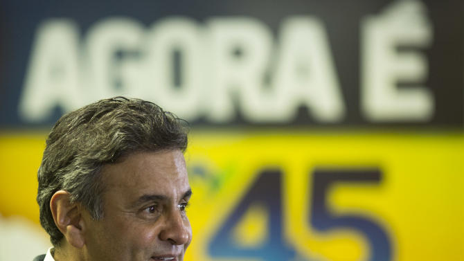Aecio Neves, Brazilian Social Democracy Party presidential candidate, talks during a press conference in Rio de Janeiro, Brazil, Thursday, Oct. 23, 2014. Neves will face Brazil's President Dilma Rousseff in a presidential runoff on Oct. 26. (AP Photo/Felipe Dana)