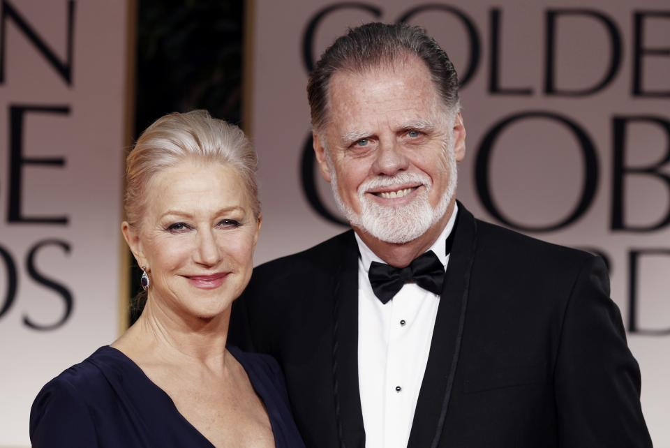 Helen Mirren, left, and Taylor Hackford arrive at the 69th Annual Golden Globe Awards Sunday, Jan. 15, 2012, in Los Angeles. (AP Photo/Matt Sayles)