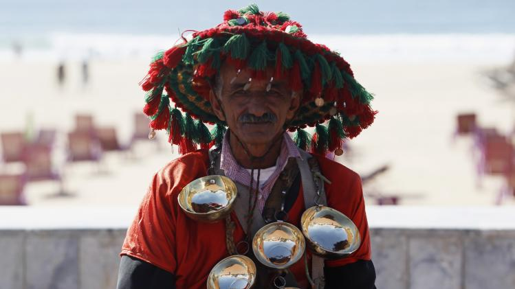 Hussien Amien, a traditional drinks seller, is seen at Atlantic beach in Agadir, one of the host cities for the FIFA Club World Cup