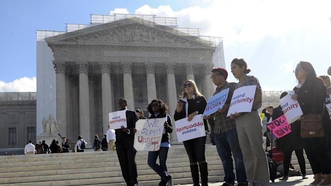 People supporting the University of Texas rally outside the Supreme Court in Washington, Wednesday, Oct. 10, 2012. The Supreme Court is taking up a challenge to a University of Texas program that considers race in some college admissions. The case could produce new limits on affirmative action at universities, or roll it back entirely. (AP Photo/Susan Walsh)