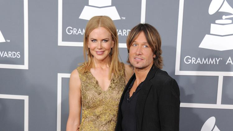 Nicole Kidman, left, and Keith Urban arrive at the 55th annual Grammy Awards on Sunday, Feb. 10, 2013, in Los Angeles.  (Photo by Jordan Strauss/Invision/AP)