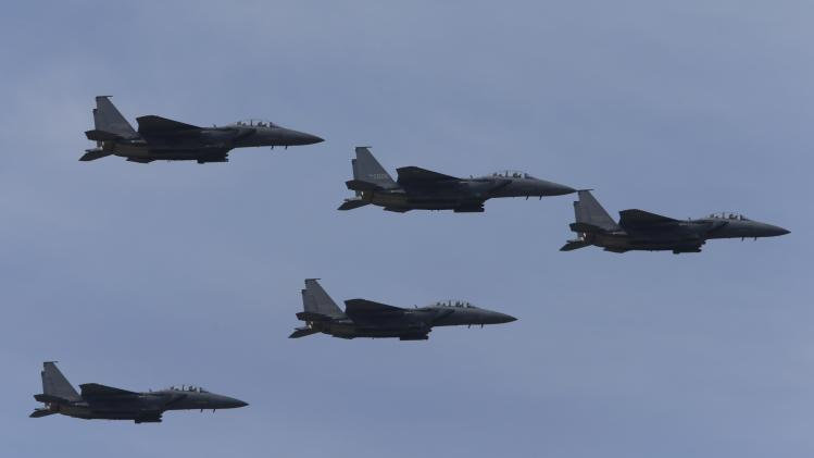 South Korean Air Force F-15K fighter jets fly in sky during celebrations to mark 65th anniversary of Korea Armed Forces Day, in Seongnam