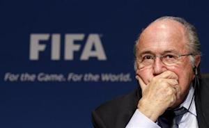 Fifa President Blatter attends a news conference after the meeting of Fifa's Executive Committee at the Home of FIFA