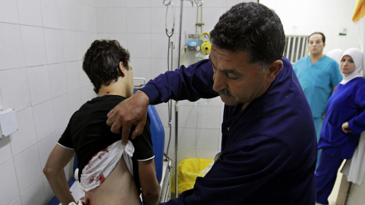 dead and more than 200 wounded, the highest toll so far. (AP Photo