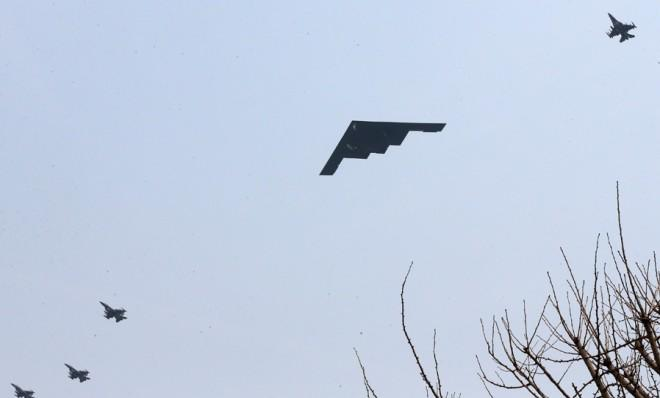 A U.S. Air Force B-2 stealth bomber flies over the Osan U.S. Air Base in Pyeongtaek, south of Seoul, on March 28.