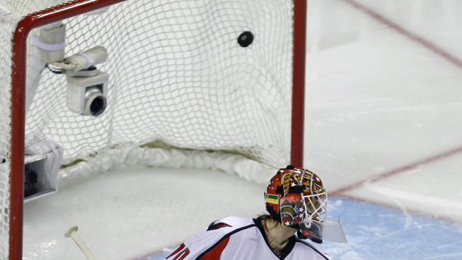 Washington Capitals goalie Braden Holtby looks back as the game-winning goal by Boston Bruins center Chris Kelly lands in the back of the net during overtime of Game 1 of an NHL hockey Stanley Cup first-round playoff series in Boston, Thursday, April 12, 2012. The Bruins won 1-0. (AP Photo/Charles Krupa)