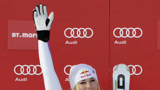 Lindsey Vonn, right, of the United States, celebrates on the podium after winning an alpine ski, women's World Cup super-G, in St. Moritz, Switzerland, Saturday, Dec .8, 2012. (AP Photo/Giovanni Auletta)
