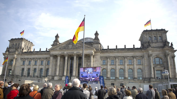 People gather outside the Reichstag building  in Berlin for a public viewing, Sunday March 18, 2012. German lawmakers are gathering in Berlin to elect the country's new president. Candidate Joachim Gauck, a former East German pro-democracy activist, enjoys the support of most major parties and appears assured of election on Sunday. Also running for the ex-communist Left Party is Nazi-hunter Beate Klarsfeld.  (AP Photo/dapd/ Axel Schmidt)