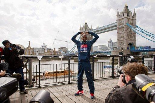 British Olympic double gold medallist Mo Farah poses for photographers in central London on April 18, 2013