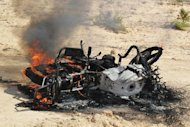 The wreckage of a burning motorbike following a raid by Egyptian security forces on the village of El-Jurah in the northern Sinai province. Egyptian security forces have killed six gunmen in a raid on a village of North Sinai, as the military pressed a campaign against Islamists in the lawless peninsula neighbouring Gaza and Israel