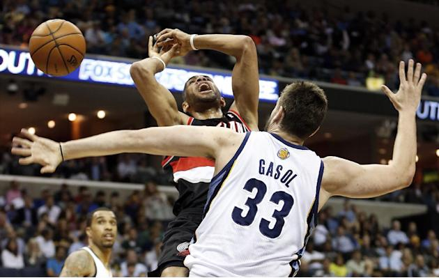 Portland Trail Blazers forward Nicolas Batum, of France, loses the ball as he drives against Memphis Grizzlies center Marc Gasol (33), of Spain, in the first half of an NBA basketball game on Tuesday,