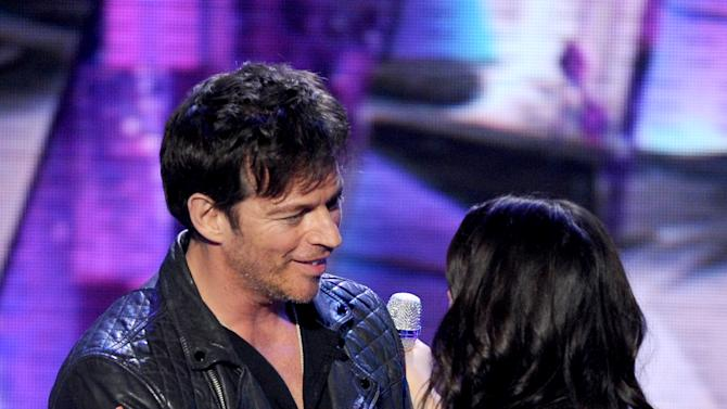 Singer Harry Connick Jr. (left) and contestant Kree Harrison onstage at FOX's American Idol Season 12 Top 4 To 3 Live Performance Show on Wednesday, May 1, 2013 in Hollywood, California. (Photo by Frank Micelotta/Invision for FOX/AP Images)