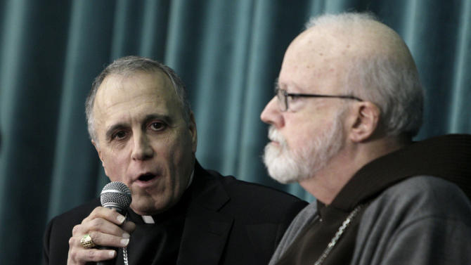 Cardinal Daniel Nicholas DiNardo, Archbishop of Galveston-Houston, left, and Cardinal Sean Patrick O'Malley, Archbishop of Boston, attend a press conference at the Pontifical North American College in Rome, Tuesday, March 5, 2013. The Sistine Chapel closed to visitors on Tuesday and construction work got under way to prepare it for the conclave, but five cardinals remained AWOL from the preparatory meetings to discuss who should run the Catholic Church following Benedict XVI's resignation.The Vatican insisted nothing was amiss and that the five cardinals would be arriving in the coming days. (AP Photo/Riccardo De Luca)