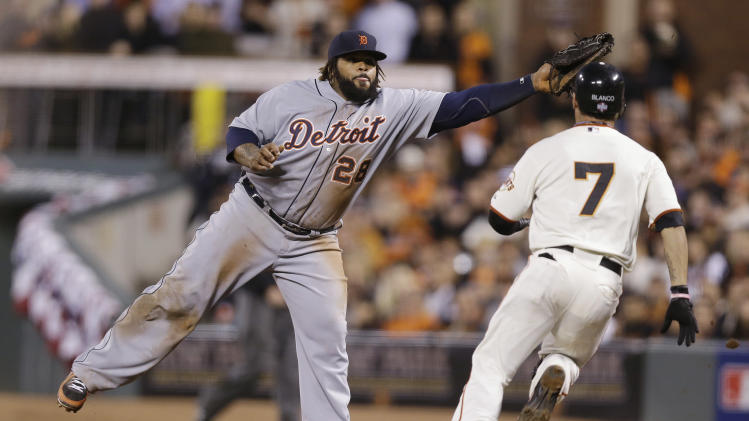 Detroit Tigers first baseman Prince Fielder takes a throw from pitcher Doug Fister  during the fifth inning of Game 2 of baseball's World Series Thursday, Oct. 25, 2012, in San Francisco. San Francisco Giants' Gregor Blanco was called out at first. (AP Photo/Marcio Jose Sanchez)