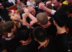 Fennville basketball coach Ryan Klingler after his emotional pregame speech before his team's first game of the 2011-12 season