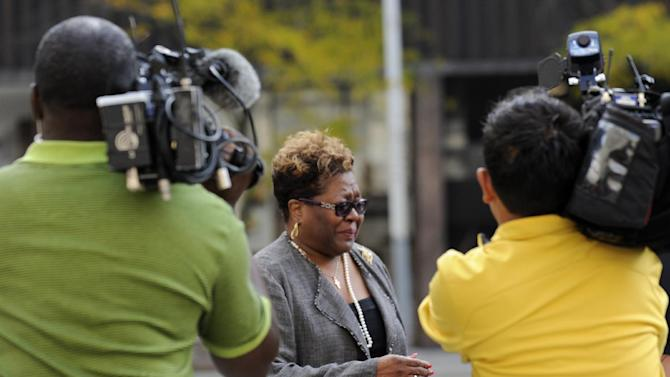 Photo of Emma Bell is followed by media in Detroit on Thursday Oct. 4, 2012.  Bell is Kwame Kilpatrick's longtime fundraiser and testified Kilpatrick's trial Thrusday.  (AP Photo/Detroit News,David Coates )  DETROIT FREE PRESS OUT; HUFFINGTON POST OUT
