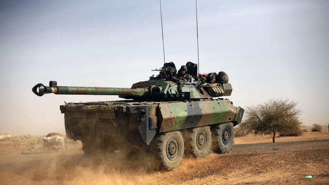 A French tank is seen heading north  at the tail end of a 60-plus military convoy in Gao, northern Mali,  Wednesday Feb. 6, 2013. Troops from France and Chad moved into Kidal in an effort to secure the strategic north Malian city, a French official said Tuesday, as the international force put further pressure on the Islamic extremists to push them out of their last major bastion of control in the north.(AP Photo/Jerome Delay)