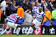 Queens Park Rangers striker Djibril Cisse (R) celebrates with teammate Taye Taiwo after scoring during the Premier League match against Stoke City on May 6. QPR has one of the worst away records in the league, winning three, drawing twice and losing 13 on the road