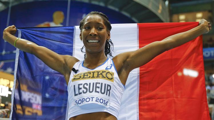 First placed Lesueur of France celebrates her victory in the women's long jump final at the world indoor athletics championships at the ERGO Arena in Sopot