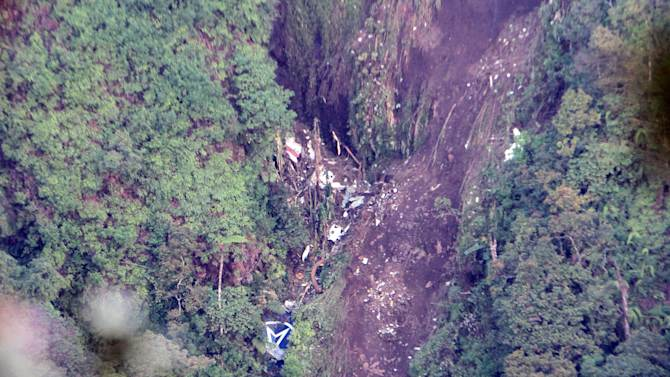 The logo of Sukhoi Co. is clearly visible, center, bottom, among the wreckage of a Sukhoi Superjet-100 scattered on the mountainside in Bogor, West Java, Indonesia, Friday, May 11, 2012. The crash of the new, Russian-made jetliner into a jagged Indonesian volcano during a flight to impress potential buyers has thrown doubt on dozens of plane sales just as Moscow seeks a comeback in foreign markets. All 45 people aboard were feared dead. (AP Photo)