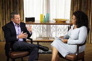 Oprah Winfrey (R) speaks with Lance Armstrong during an interview regarding the controversy surrounding his cycling career on January 14, 2013.
