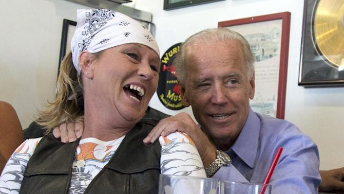In this Sept. 9, 2012, photo Vice President Joe Biden visits with patrons over lunch at Cruisers Diner in Seaman, Ohio. Biden buddied up with bikers, posed for countless pictures at a pizza place and downed an ice cream cone at a Dairy Queen over the weekend as he toured Ohio. Biden loves Ohio. The only question now is whether Ohio loves him _ and President Barack Obama. (AP Photo/Carolyn Kaster)