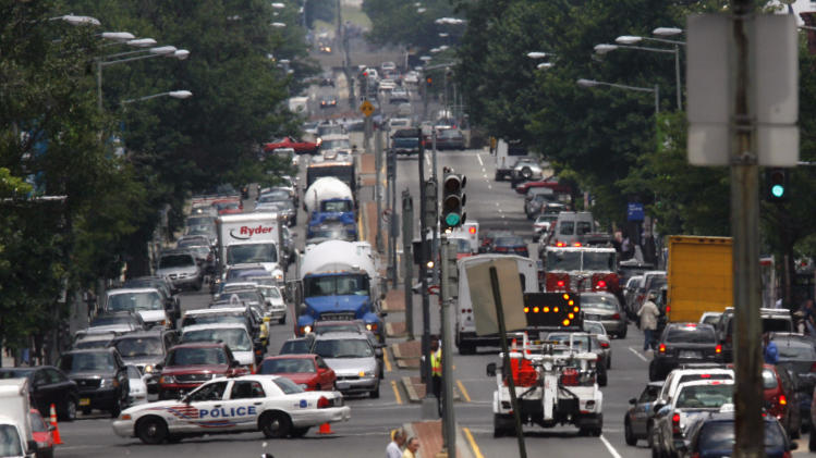 FILE - In this June 14, 2007 file photo, Washington police block traffic on Massachusetts and North Capitol Street in Washington. Rural places account for just 16 percent of the nation's population, the lowest share ever, while metro areas are booming into sprawling megalopolises. (AP Photo/Jacquelyn Martin, File)