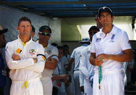 Captains Clarke of Australia and Cook of England stand in the player's race before the start of the third Ashes test match in Perth