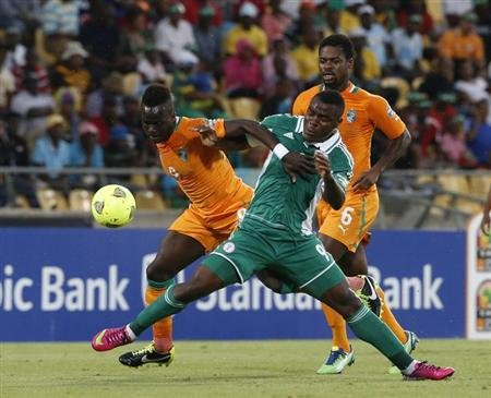 Ivory Coast's Cheick Tiote (L) tackles Nigeria's Emmanuel Emenike (R) during their African Nations Cup (AFCON 2013) quarter final soccer match in Rustenburg, February 3, 2013. REUTERS/Mike Hutchings